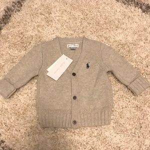 Light grey button up sweater